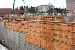 Construction of a concrete wall using MDO plywood for an apartment complex in Tacoma, Washington
