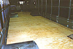 Wood structural panel truck floor